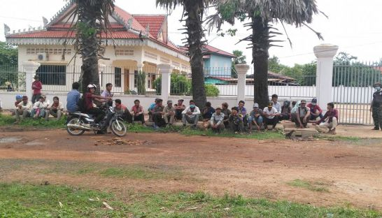 people_sit_outside_a_court_in_preah_vihear_province_yesterday_where_community_members_were_questioned_over_a_land_dispute_22_06_2016_supplied