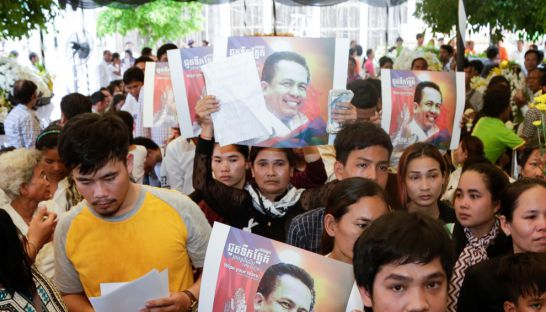people_hold_up_kem_ley_posters_at_the_political_analysts_funeral_in_phnom_penhs_chroy_changvar_district_last_month_17_07_2016_heng_chivoan