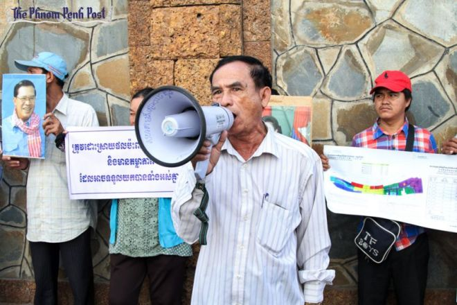 a_chroy_changvar_community_representative_speaks_through_a_megaphone_earlier_this_month_during_a_protest_against_ocic_at_the_ministry_of_land_07_09_2016_hong_menea