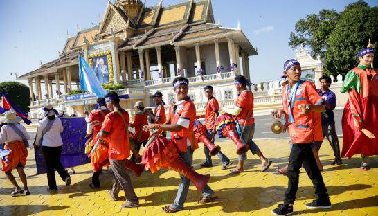 people_march_past_the_royal_palace_late_last_year_during_human_rights_day_event_in_the_kingdoms_capital_10_12_2015_hong_menea