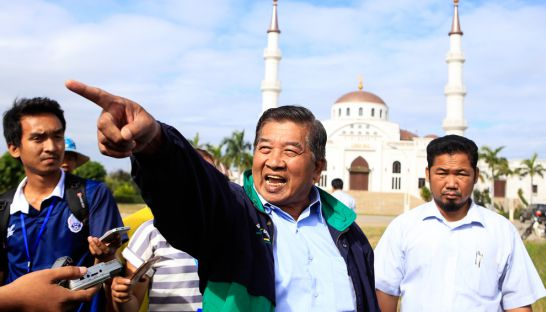 1_cham_community_leader_ahmad_yahya_stands_outside_a_mosque_in_phnom_penhs_boeung_kak_district_yesterday