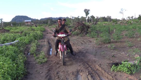11_uk_mao_rides_his_bike_in_the_land_where_they_have_claimed_illegal_clearing_of_community_forest_land_supplied_