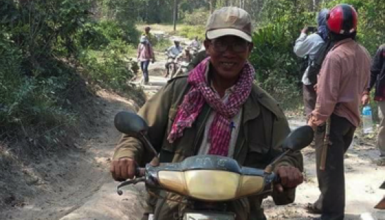 9_phai_bunleang_on_his_bike_in_kratie_province_earlier_this_week_supplied