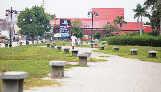 a-man-strolls-along-a-path-at-the-future-site-of-freedom-park-in-phnom-penhs-russey-keo-district-along-national-road-5-hong-menea