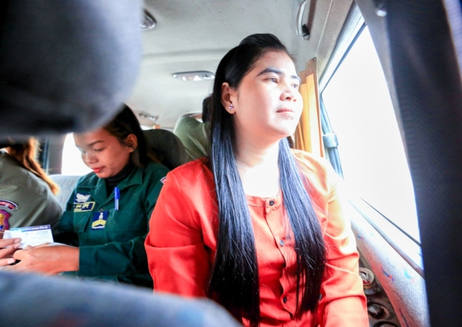The activist in a van heading back to prison after her court appearance. KT/Chor Sokunthea