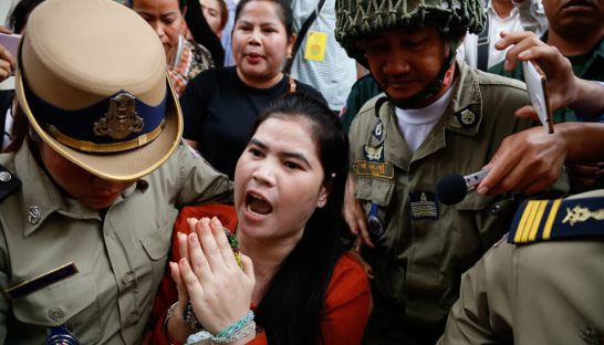 Land rights activist Tep Vanny is escorted by officials yesterday outside Appeal Court in Phnom Penh. Hong Menea