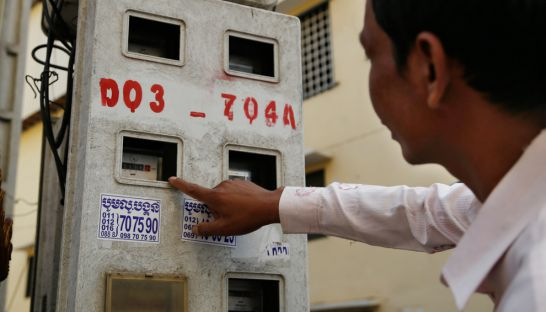 A man inspects the electricity meters in Phnom Penh yesterday. Pha Lina