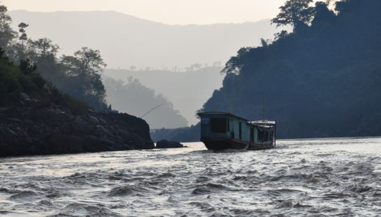 A boat makes its way down the Mekong River near the proposed Pak Beng Dam site, downstream of Chiang Khong district, Chiang Rai. Pianporn Deetes/International Rivers