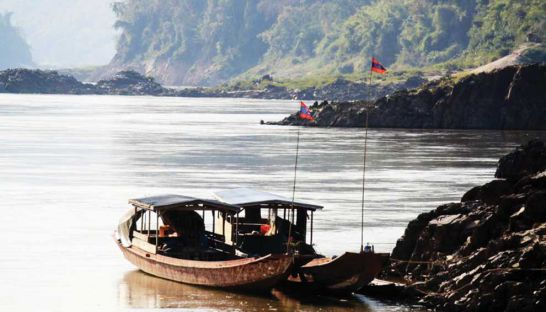 boats-dock-on-the-bank-of-the-mekong-river-in-northern-laos-last-year-at-the-planned-construction-site-for-the-pak-beng-dam-international-rivers-1