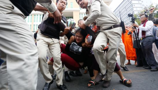 Boeung Kak lake activist Bov Sophea is dragged by officials during a violent clash outside the Phnom Penh Municipal Court after fellowactivist Tep Vanny's trial yesterday. Heng Chivoan