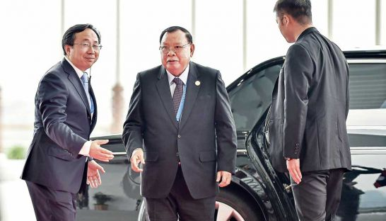Laos President Bounnhang Vorachith (centre) arrives at a G-20 Summit last September. AFP