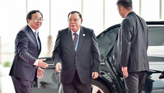 Laos President Bounnhang Vorachith (centre) arrives at a G-20 Summit last September. AFP