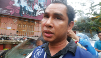 Licadho's head of monitoring, Am Sam Ath, speaks to the press after he was hit by security forces at a World Habitat Day march last year in Phnom Penh. Heng Chivoan