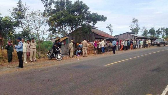 authorities_stop_villagers_from_blocking_a_road_to_protest_their_dispute_with_the_memot_rubber_company_in_kratie_in_2015._locals_have_renewed_their_protest_there_this_week._adhoc