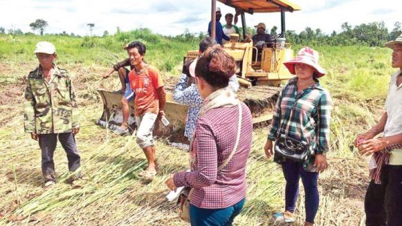villagers_involved_in_a_land_dispute_attempt_to_block_a_tractor_clearing_their_rice_fields_following_an_august_court_order_granting_their_land_to_a_rubber_plantation_company_in_oddar_mea